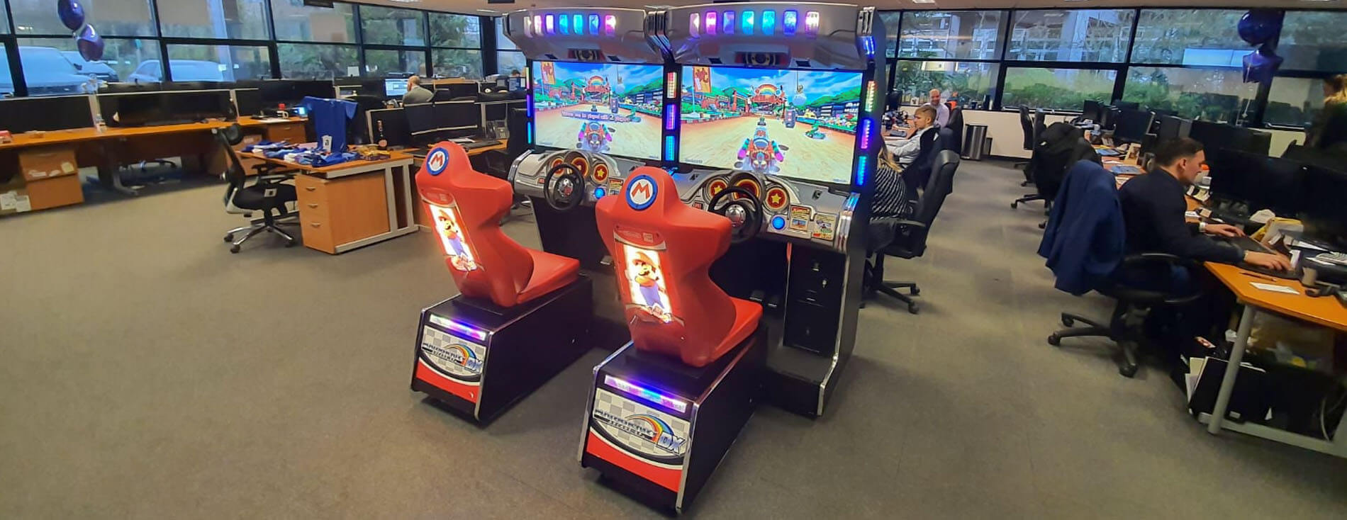 Mario Kart DX arcade machine hired for an office space