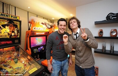 David Luis and Júlio César with our Indiana Jones Pinball and Grid Racing deluxe arcade games for hire