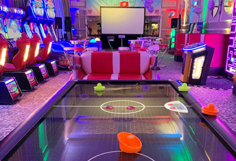 Air hockey and multiple arcade games set up a full arcade installation for hire